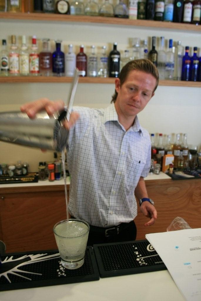 Brandhouse Mixologist Alex Farnell at work in the Barcode Bar